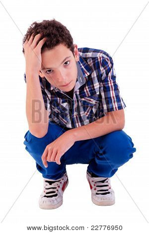 Young Man Squatting, Worried, Isolated On White Background Studio Shot