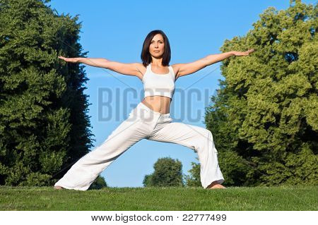 young woman doing yoga outside