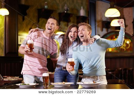 Young people rejoice at the pub