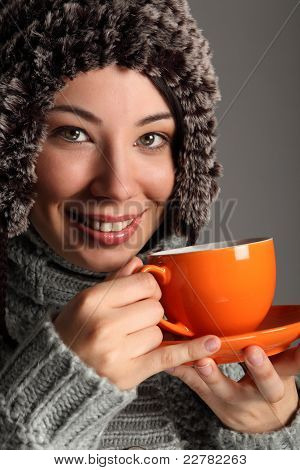 Beautiful Girl In Warm Wool Hat Drinking Tea
