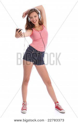 Happy Long Legged Teenage Girl Has Fun With Music