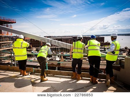 Supervisors overseeing a construction site - new industrial development