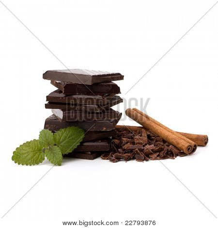 Chocolate bars stack and cinnamon sticks isolated on white background