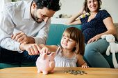 Family saving money in piggy bank poster