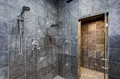 Luxurious Mansion Walk-in Shower With Black Square Tiled Walls poster