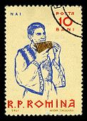 ROMANIA-CIRCA 1961:A stamp printed in ROMANIA shows image of The pan flute or pan pipe  is an ancien
