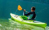 Recreational Kayak Trip. Caucasian Men In The Kayak On The Scenic Lake. poster