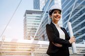 Young Asian Business, Engineer Or Technician Woman In Suit With White Safety Helmet Looking To Futur poster