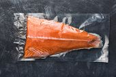 Salmon Fillet Packaged In Plastic Vacuum Pack. Fresh Fish In Packing Sell In Supermarket. Metal Blac poster