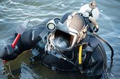 Commercial  Diver With Scuba Gear Working In The Water, Occupation In The Offshore Industry poster