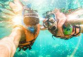 Senior Happy Couple Taking Selfie In Tropical Sea Excursion With Water Camera - Boat Trip Snorkeling poster