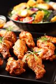 stock photo of chicken wings  - Photo of Hot chicken wings on baking tray - JPG