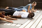 Tired Diverse African And Caucasian People Relaxing Smiling Having Fun Lying On Mat Floor At Yoga Cl poster
