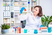 Girl Scientist Holding Laboratory Flask In Hand. Researcher Researching In The Laboratory. Reagent F poster