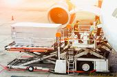 Air Freight Services Or Airplane Transportation, Operator Loading Cargo On Plane In Airport. poster