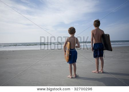 Young Boys at the Beach with Boogie Boards