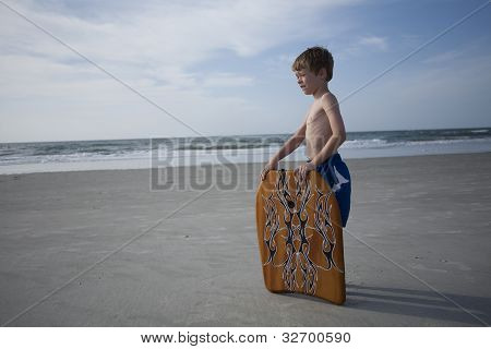 Young Boy at the Beach with a Boogie Board