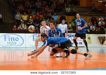 KAPOSVAR, HUNGARY - APRIL 21: Andras Geiger (C) in action at a Hungarian National Championship volleyball game Kaposvar (blue) vs. Kecskemet (black), April 21, 2012 in Kaposvar, Hungary.