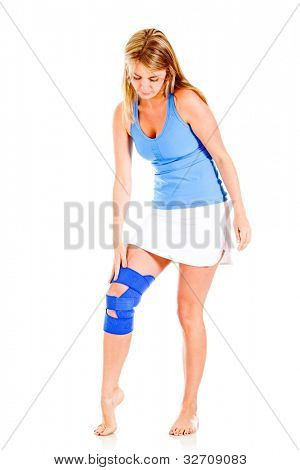 Woman with a knee injury - isolated over a white background