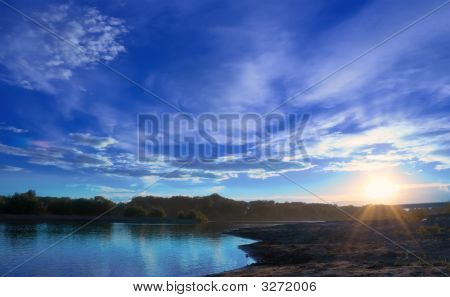 Sunset On The Coast Of The River