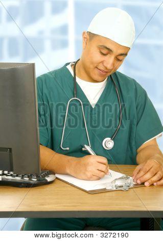 Nurse Writing On Clip Board