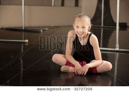 Happy Ballerina Sitting On Floor