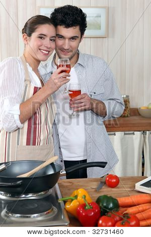 Couple in kitchen with glass of wine