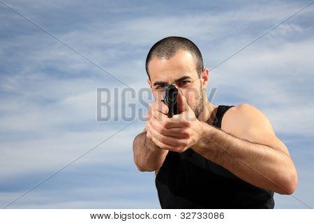 Male Bodyguard With A Gun