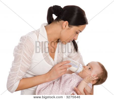 Mother Feeding Baby Daughter