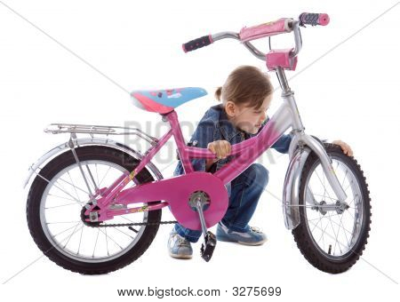Young Girl Isolated On White Repair Her Bike
