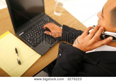 Business Man On The Phone And Computer