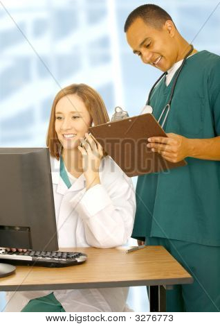 Doctor On The Phone With Male Nurse