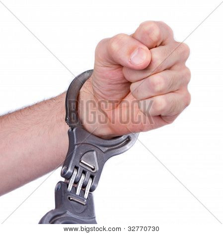 A Man In Metal Handcuffs On A White Background