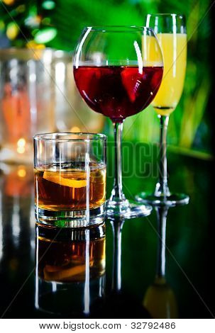 Three Different Beverages, Glass Of Whiskey, Glass Of Red Wine And Yellow Cocktail