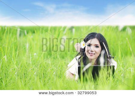 Asian Woman Using Laptop Outdoor