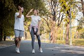 Young Couples Jogging In The Park. poster