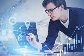 Young Market Analyst In Casual Clothes And Glasses Working With Digital Business Interface In Blurry poster