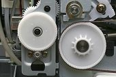 foto of nylons  - Nylon gears and cog wheels inside computer printer - JPG