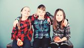 Boy And Girls Friends In Similar Checkered Clothes Eat Apple. Teens With Healthy Snack. Healthy Diet poster