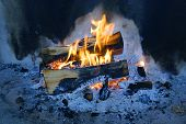 picture of smut  - firewood burning at the fireplace close view - JPG