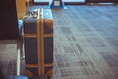 Brown Suitcases At Airport Departure Lounge Traveler In Airplane Terminal Background,traveling Bagga poster