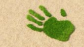 Concept or conceptual green grass handprint on hay background. A metaphor for ecology, environment,  poster