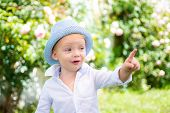 Funny Child Face. Happy Child In Summer In Nature. Portrait Of Happy Smiling Child Boy On Nature Bac poster
