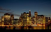 stock photo of new york skyline  - image of the new york city skyline at night - JPG