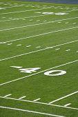 stock photo of ncaa  - A new astro turf foot ball field - JPG