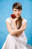Attractive Brunette With Red Rose