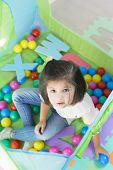 Little Smiling Girl Playing Lying In Ball Park. Close Up, Portrait poster