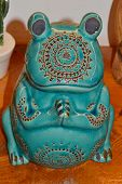 Ceramic Frog Coated With Turquoise Glaze Sitting On Its Hind Legs. poster