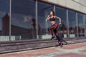 Sport Girl Runs Summer City. Sportswear Leggings Top. Background Showcase Glass Windows. Motivation  poster