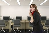 Businesswoman Or Office Worker Looking Upset And Anxious Because She Is Alone In The Workplace.  She poster